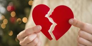 Studio Shot of female's hands holding broken heart